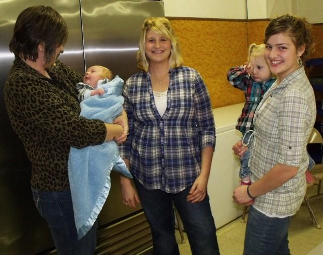 JoAnn Kruse, Blase Ryland, Francesca Ryland, Maggie holding little Kallie Jo Ryland.