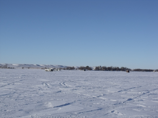 Taking in the view of the other ice houses as we drove up to our fishing spot. See the lovely hills in the background.