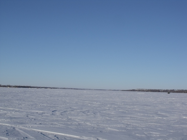 A distant view of another little cluster of ice houses on the huge lake.