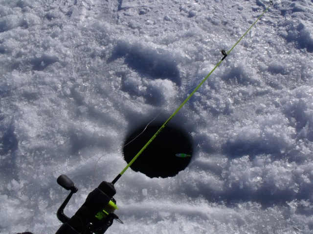 My first ice fishing hole set up with ice 14 inches thick!