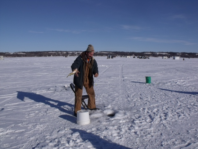 Fred tosses a fresh catch to be chilled on ice very rapidly.  Our luck had just picked up.