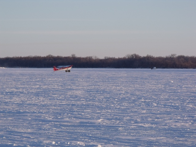 A small plane landed on the frozen Minnesota/South Dakota border lake to take in some ice fishing.