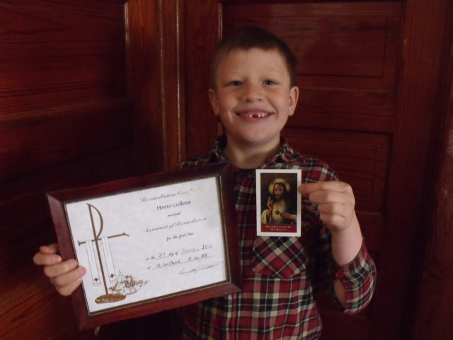 Mario with his certificate and the holy card given to him by Father Craig Timmerman.