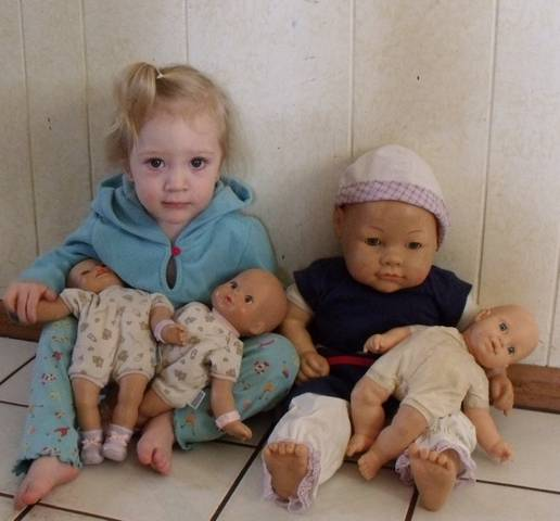 Kallie Jo with Bella's baby doll collection.  Too cute.........