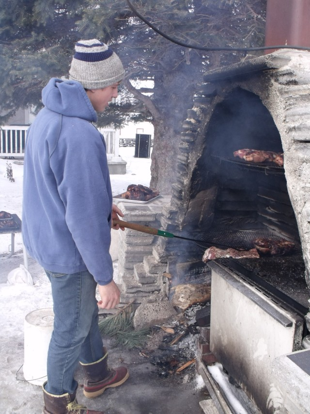 Caleb smoking the bacon and hams from the hog we processed recently.