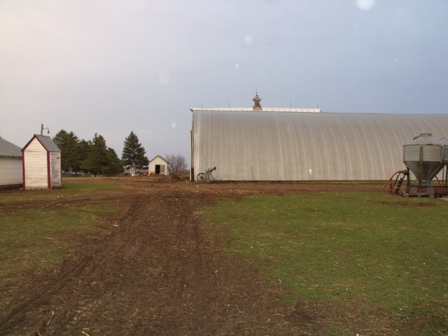View of the quonset and the dirt being leveled.