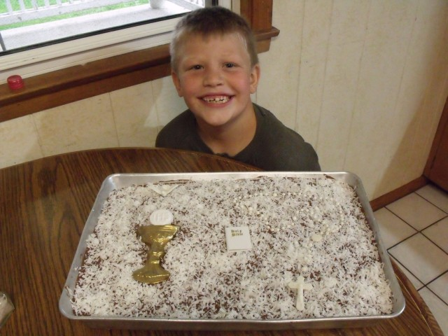 Mario with his home made Chocolate Crazy Cake that Maggie made. Frenchy made chocolate cream cheese icing.  Nonna informed us that it had to be white for First Communion........no problem. We topped it with white coconut.  It was divine tasting.