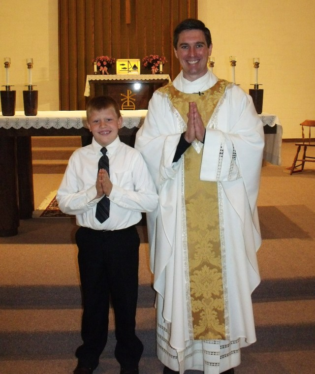 Mario Callens and Father Craig Timmerman at St. Leo Catholic Church for First Holy Communion!