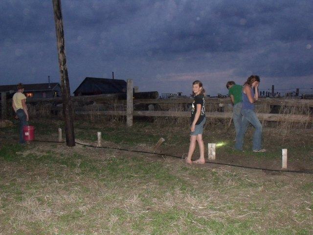 Hurrying to plant the grass seed before the rain last night.