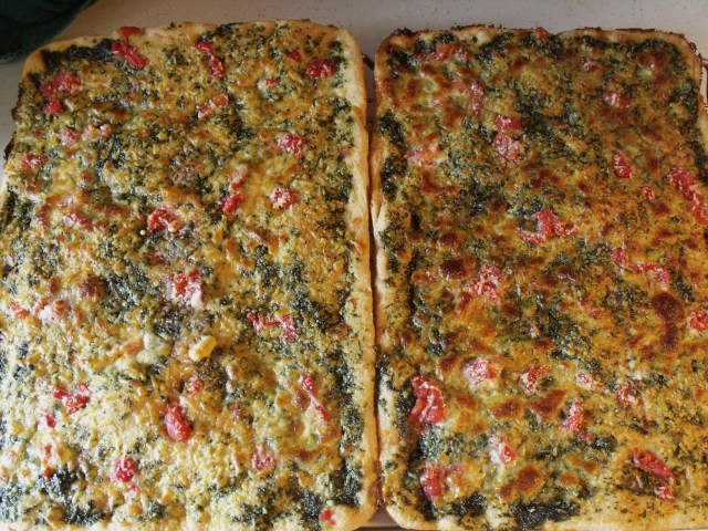 Fresh Pesto Pizza.  This is one of the best pizza's I have ever made.  Blend fresh basil, olive oil, a ton of fresh garlic, s and p.  Rub on the pizza dough, top with fresh tomatoes, parmesan, mozzarella and bake.  The delicious aroma will drive everyone crazy!
