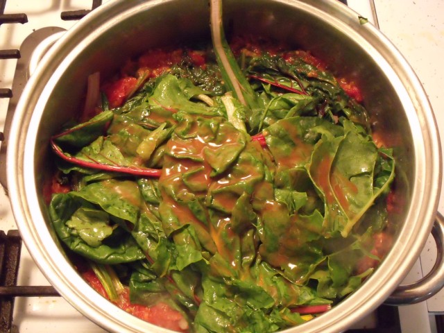 Swiss Chard in Marinara Sauce!  Fry 3 garlic cloves and brown lightly in olive oil.  Throw in crushed tomatoes, salt, papper and sweet basil.  After it boils drop in a few leaves of swiss chard at a time until they shrink down in size. Simmer, add Red Hot sauce if you like and either eat as a soup or serve over any kind of pasta.