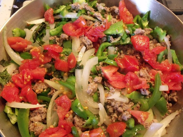 Sausage and peppers.  Brown pork, add onions, tomatoes, salt, pepper, garlic and sweet basil.  Eat hot, cold or in a ciabatta bun with mayo.  Delicious and easy.