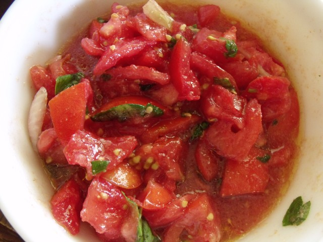 Tomatoe salad.  Simply, cut tomatoes and sweet onions. Add salt, pepper, olive oil, sweet italian basil and a ton of garlic, fresh or powder.  Eat plain or with crusty dipping bread.