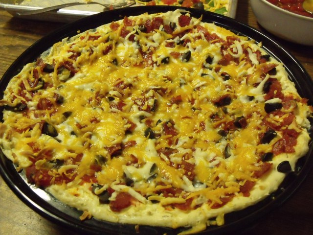 This is a delicious Hot Pepperoni Pizza Dip.  This was made by Maggie and Frenchy for a pre-Lent gathering.
