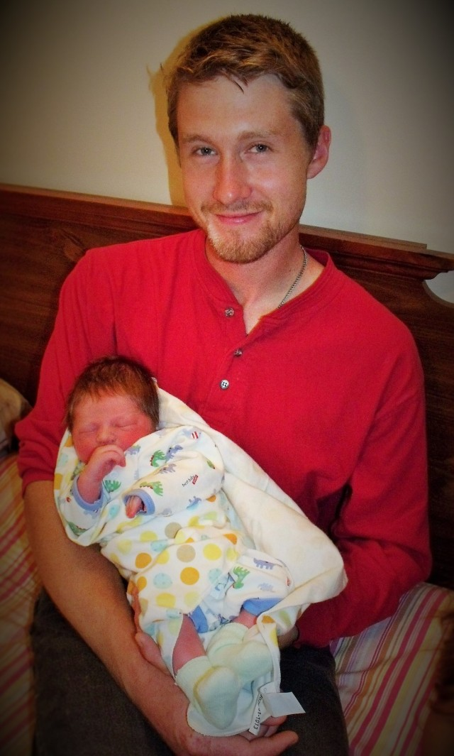 Luke with his newborn baby boy.  Life doesn't get much better than this !