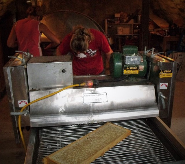 The frame of honey enters the machine.