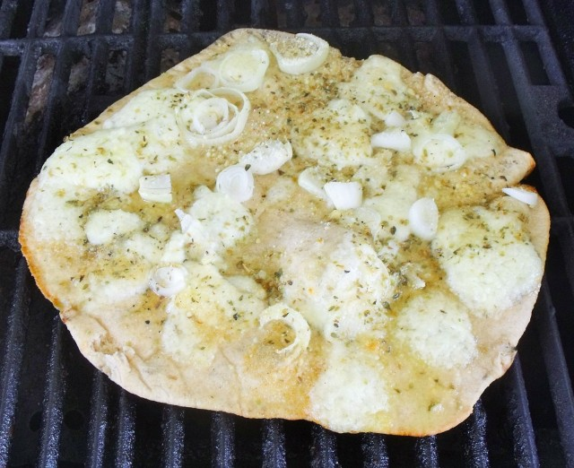 Focaccia...white pizza grilled with our own cheese! Oh Boy........