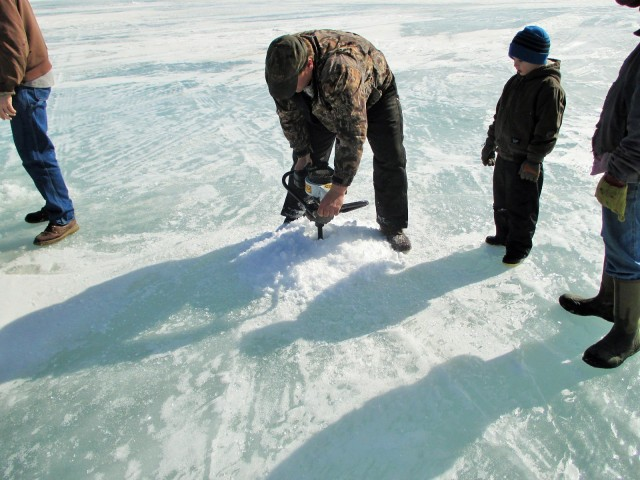 Don digging our fishing holes in 32 inch thick ice!