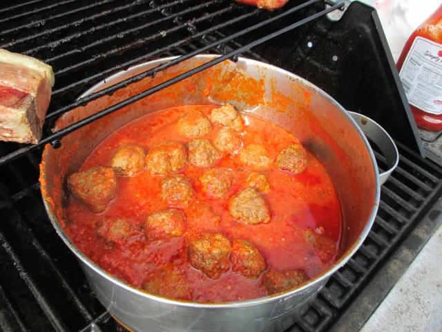 Meatballs with plenty of hot sauce to warm up a body on ice!