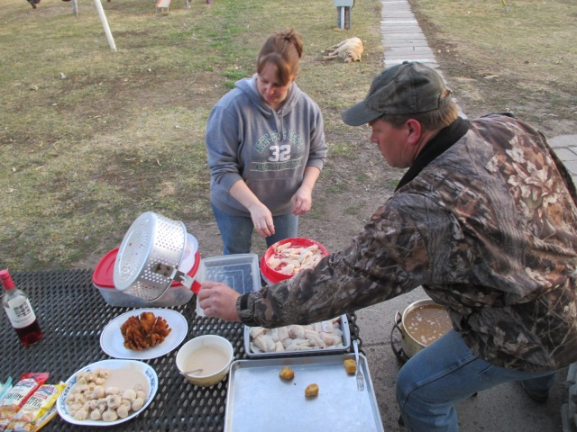 Angela and Don cooking up fish fried onions, mushrooms and cauliflower.  Delicious!