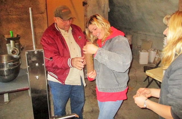 Alan gives Silvana her first sausage stuffing lesson on our new stuffer. He used to own a butcher shop out in Wyoming!