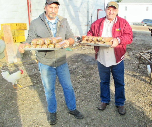 Fred and Alan carrying out a load of sausages to be cooked in the smoker.