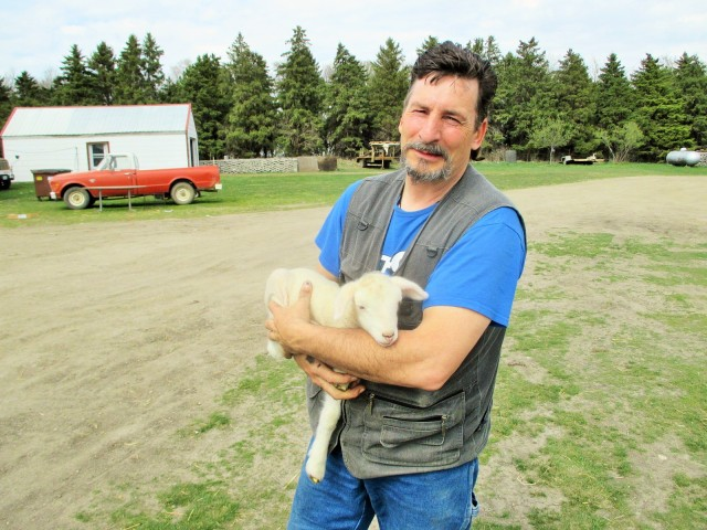 My shepherd husband Fred with a bottle lamb.