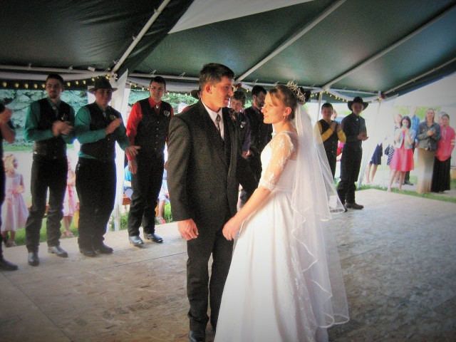 Outdoor dance floor right next to the church hall. Clayton and his beautiful bride, Angelica!