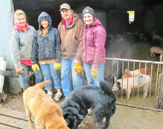 Silvana Bella Dad and Marisa working with the Organic hogs!