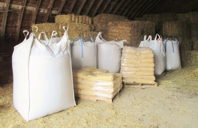 Organic feed for the hogs stays dry in the Quonset.