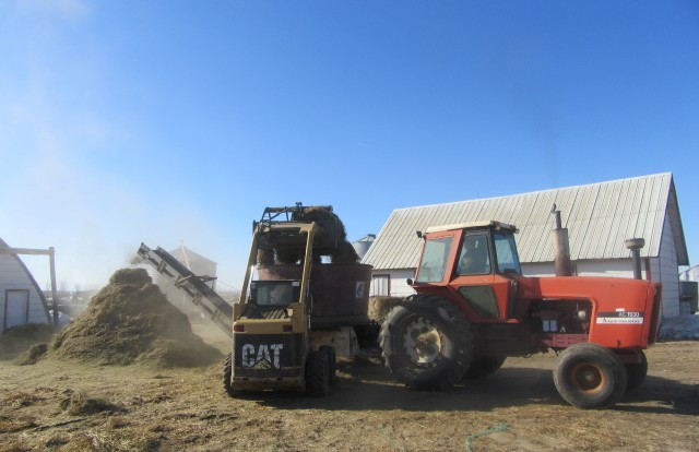 Great weather for grinding up feed for the livestock. From dreary muddy days to blue skies.