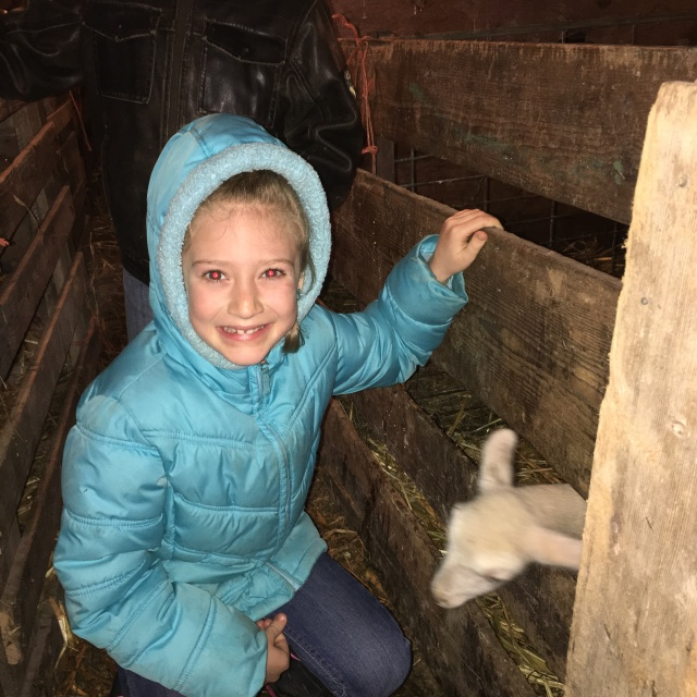 Kallie with an Easter lamb.
